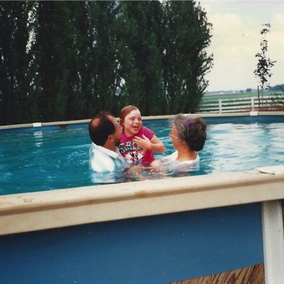 1995-Mary is baptized with the assistance of Pastor Philip and Mary Bess.